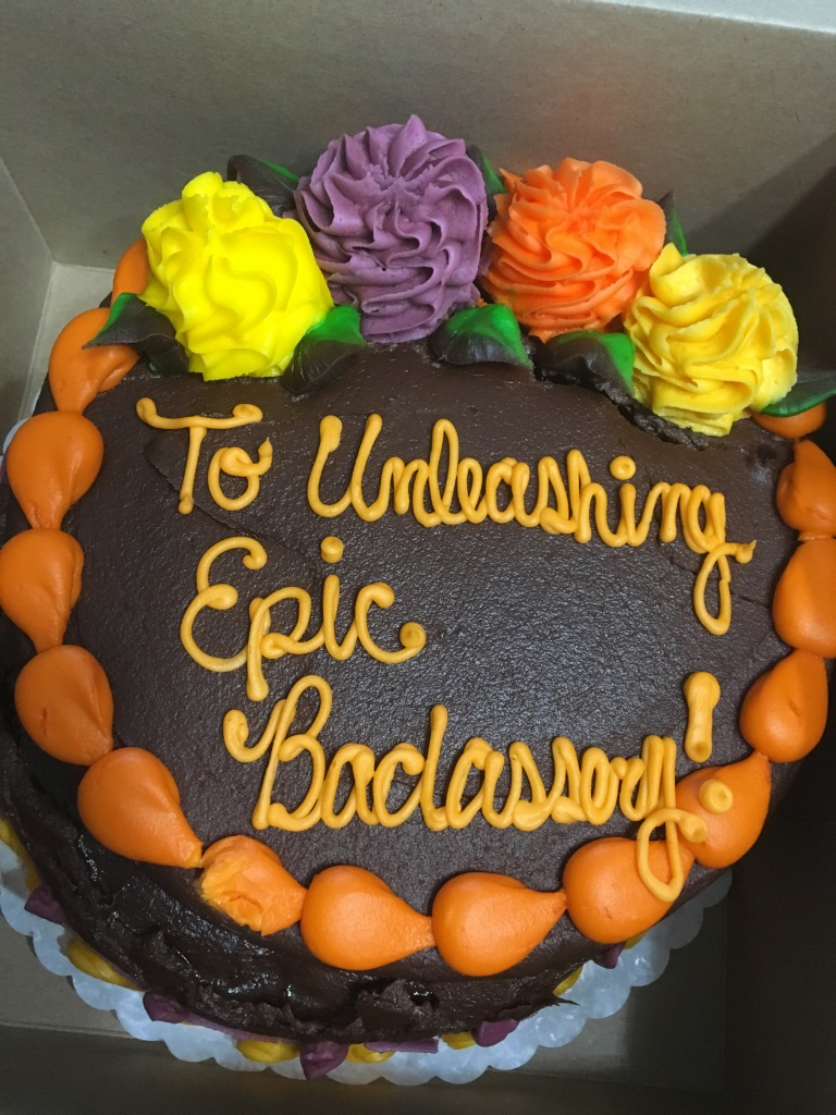 "A photo of my 40th birthday cake from my wonderful, supportive husband. It reads ""To unleashing epic badassery!"""